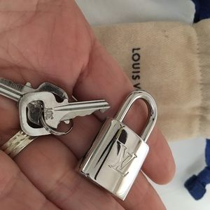 Louis Vuitton Lock And key silver crome